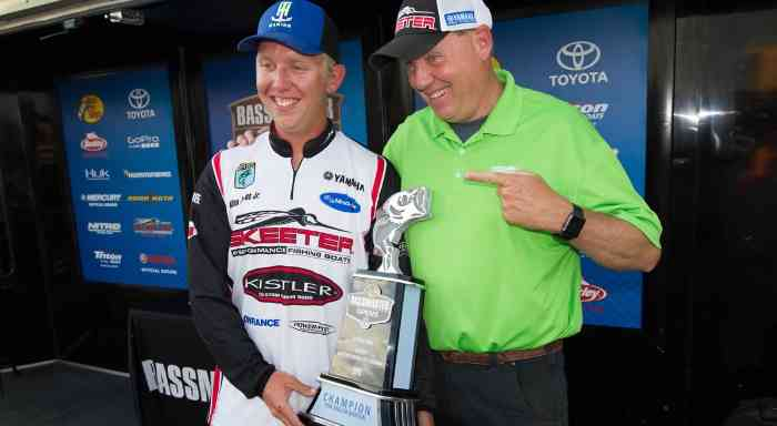 Bassmaster father and son duo with their award