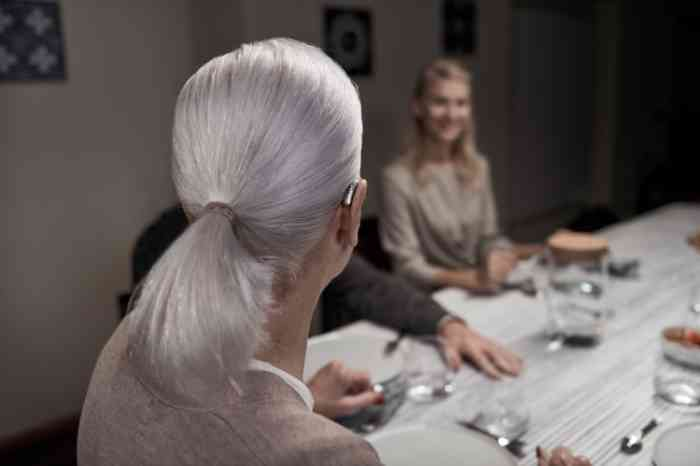 woman wearing hearing aid at dinner table