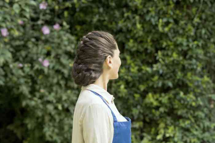 Profile of a woman with invisible hearing aid while gardening