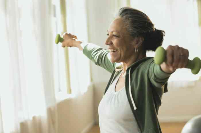 A smiling woman doing exercises at home
