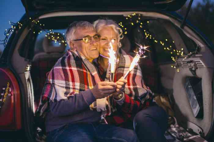 couple in car watching fireworks