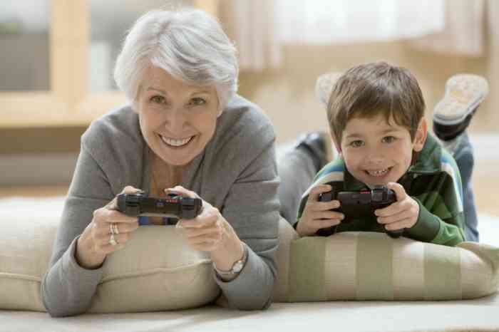 Grandmother and grandson playing videogames
