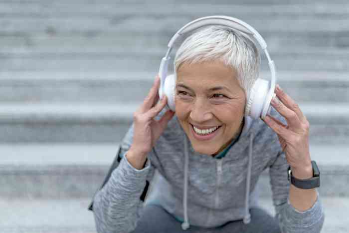 Elderly woman listening to music with her headphones
