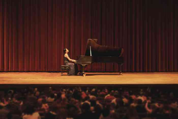 Girl playing the piano during a concert