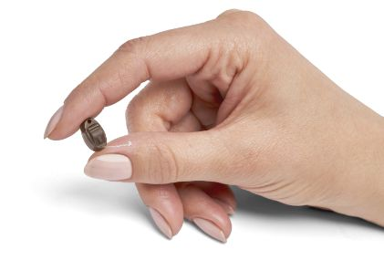 CIC hearing aid in a hand