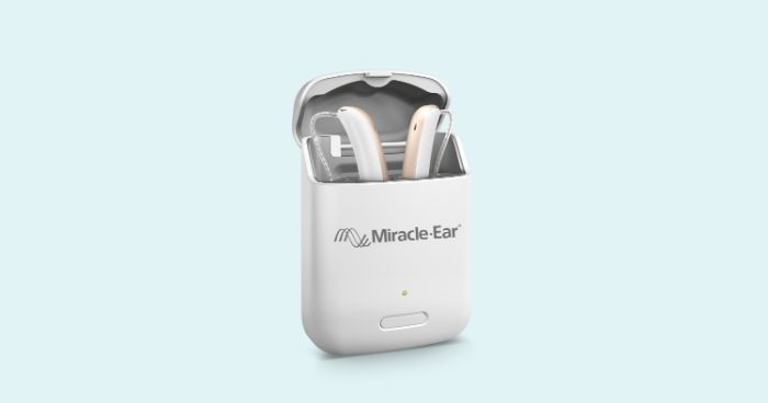 Portable hearing aid charger