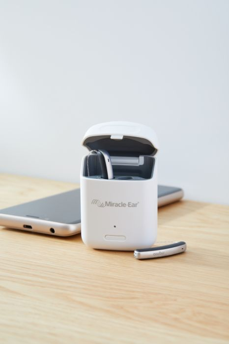 Rechargeable hearing aid in its charger