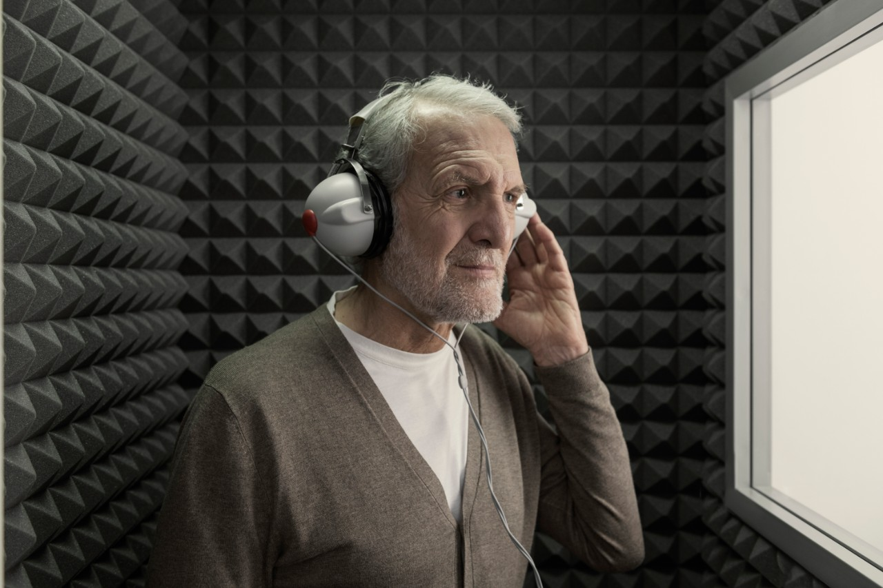 Elderly man with headphones during a hearing test