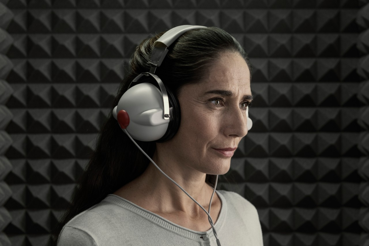 Woman with headphones during a hearing test