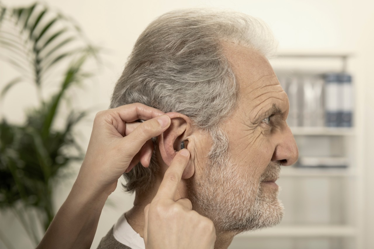 Profile of an elderly man with nearly invisible ITE hearing aids